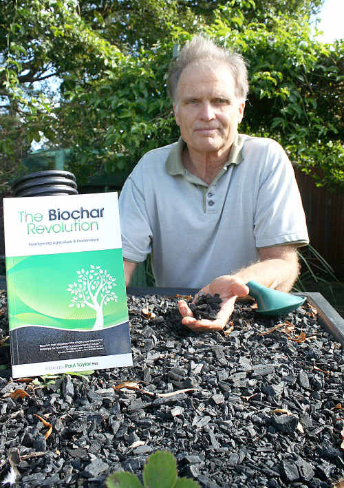 Paul Taylor with his book and some homemade biochar.