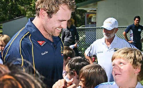 Rocky Elsom gets a warm welcome at Tewantin State School.