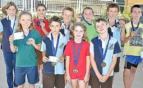 (front, from left) Elizabeth Mulliss, Kyle Piovesan, Tiarna King, Mitchell Hoffman, (back) Julieanne Johnson, Ashleigh Browne, William McDonnell, Tahnee Small, Jordan Piovesan and Dion Doro won their age groups' cross country at Warwick East State School.