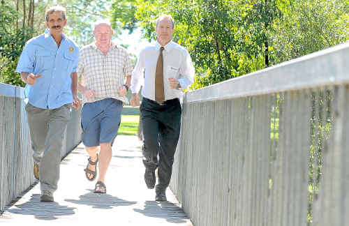 Coffs Harbour Rotary president Daryl Redford (left), organiser Mick Maley and Warren Hughes, branch manager Bendigo Bank, get in training for the Bendigo Bank Coffs Harbour Half Marathon.