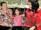 Vickie Cora (left), Naarah and Loretta Rotumah outside the Minjungbal Aboriginal cultural centre. Photo: John Gass