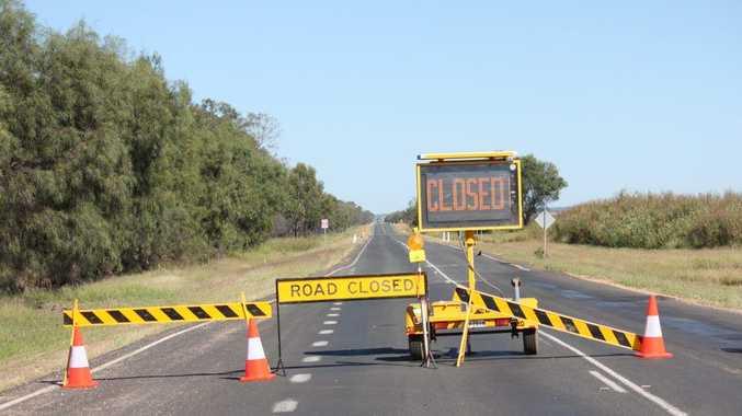 A road closed sign at the fatal crash near Emerald.
