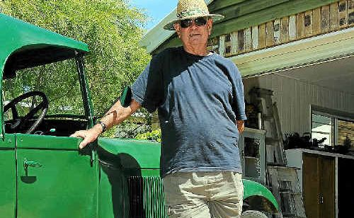 Ray McEwen and his 1928 Model A Ford at his Tannum Sands home.