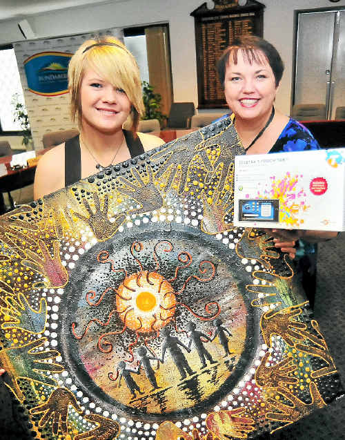 Chern'ee Sutton donates one of her paintings to Mayor Lorraine Pyefinch as the major raffle prize.