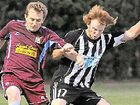Ryan Collins, of Brothers Aston Villa and Shannon Fisher, of Bingera, fight for the ball.