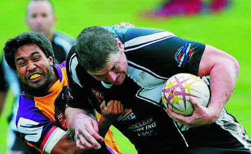 Magpie Xavier Sullivan (right) is brought to the ground by the Rhinos at McKittrick Park.Photo: Debrah Novak