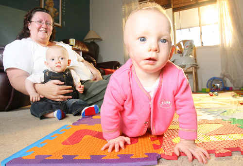 Debbie Smart with twins Lochie and Grace (right). Grace was diagnosed with congenital birth defect microtia and atresia.