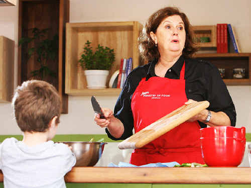 Food trainer Jennifer Hill gives a cooking demonstration at Jamie's Ministry of Food . Photo: Rob Williams