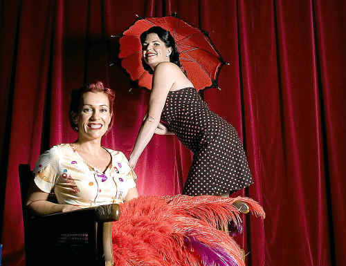 (standing) Deana Nicholas, of Brisbane and Kate Morgan, of the Northern Rivers, poses for a portrait at a burlesque and pin-up workshop, ran by Viola Vixen, of Byron Bay, at the Byron Bay Entertainment Centre on Saturday.