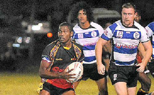 Rodrick Gela, of Woorabinda Kangaroos, looks to set up an attack against Brothers.