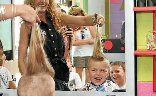 Kreative Kids Kutz Jodie Hughes shaves six-year-old Charli Harrison's hair.