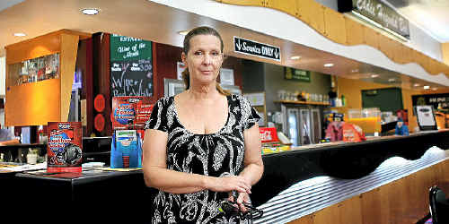 North Rockhampton Bowls Club manager Suzanne Lund at the club bar which was robbed by two masked thieves on Saturday night.