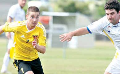 Sunshine Coast Fire's Jason Hicks breaches the Gold Coast Stars defence at Kawana.
