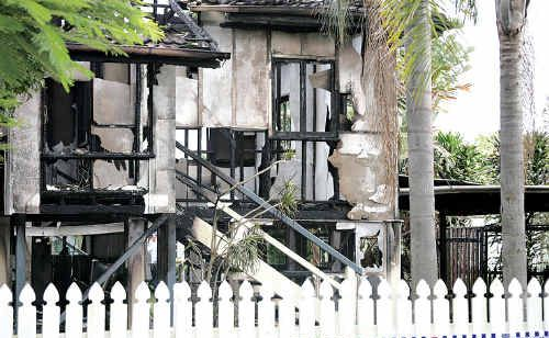 Two people died while one young woman escaped the fire which destroyed a Beachmere house yesterday.