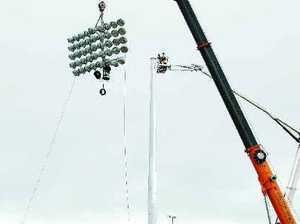 Light towers go up at stadium