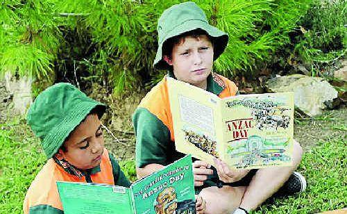 David Doolan, 11, and Mark Lisle, 11, are preparing for Anzac Day at Yarwun State School.
