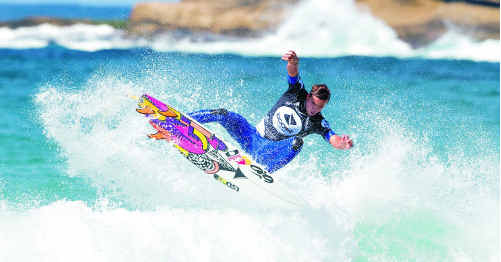 Coolum's Julian Wilson, strutting his stuff at Bondi Beach, is ready to tackle the waves at Bells Beach and the high-profile competitors he'll be up against.
