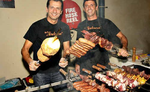Fernando and Joao of Art of Barbecue turn it on at the Kawana Chamber networking night at National Storage.