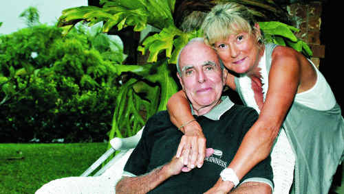 Noosa Coastguard Crew Member Jeff Kitchen recovers at home with wife Leila after a near death experience at Noosa.