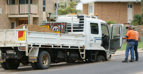 A council truck gets caught in a deep pothole on Egerton St in December last year.