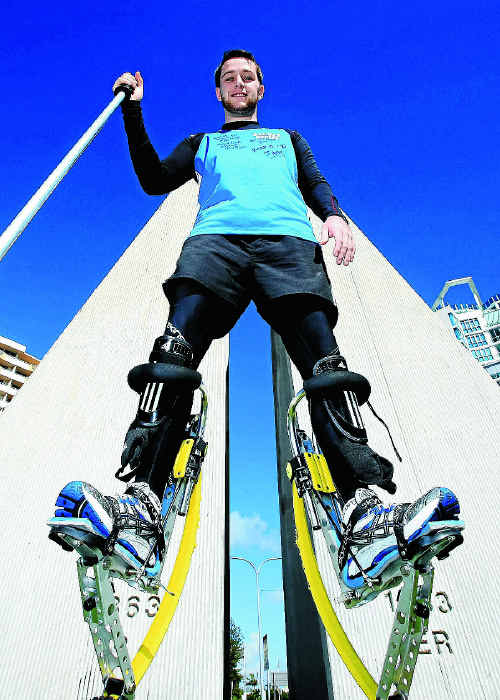 Matthew Martin is walking on stilts from Brisbane to Sydney to raise money for a very worthy cause. Photo: Blainey Woodham twe200411stilts2