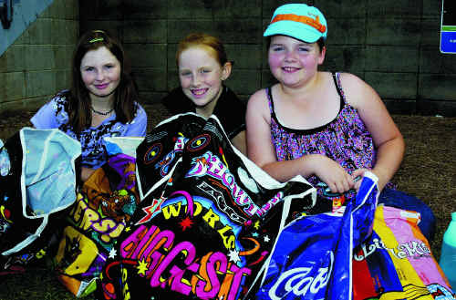 Taking a break with their showbags last year are Rose Jones, Kaitlyn Lilley and Peta-Fay Forsyth from Maryborough.