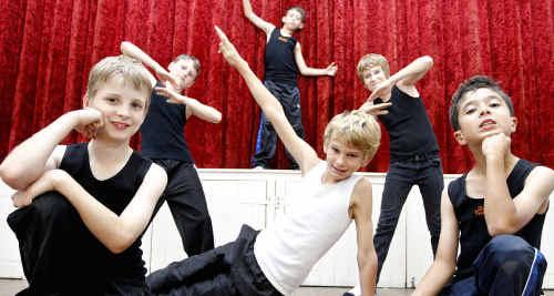 Nick Jen, Cameron Hejda, Tyron Daniels, Kelly Robinson, Jonathan Doyle (black l-r) and Lache Cutter (white) are taking dance classes.