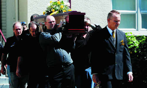 Richard Cooper's coffin is carried from the Salvation Army citadel in Gregory Street yesterday morning.