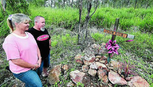 Tracey and Wayne Rich remembering their son Jason on the Rockhampton-Yeppoon Road where he died in a car accident in 2009.