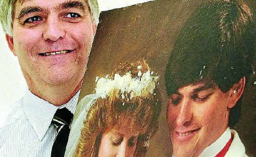 Helidon resident Rick Emmerson is reunited with his wedding portrait which was presumed lost after January 10. The portrait was salvaged from the mud and debris near Lockyer Creek.