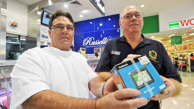 Park Beach Plaza butcher Russell Greenwood and Bob White from the SES with the replacement unit.