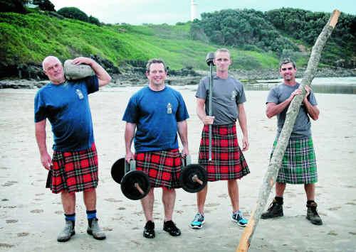 READY AS EVER: Caesar McCracken, Stig McCracken, Phil McCracken and Doug McCracken prepare at Main Beach on Thursday. Today they take to the Highland Games in Maclean. Photo: Rodney Stevens