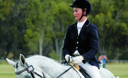 Eleanor Osborne and High Intensity in one-star dressage action at Morgan Park.