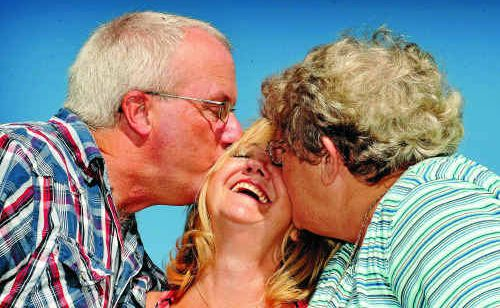 Stan Phillips, of Geelong, Carol Jones, of Sydney, and Jan Hinde, of Yamba, have a family hug in Yamba on Saturday.