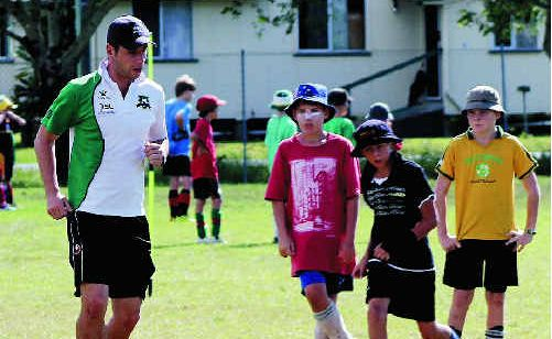 Daily Mercury Whitsunday Miners coach Graham Harvey shows off some of his skills during a Miners Football Clinic at Harrup Park.