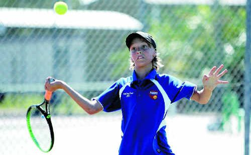 Jayden Paull of Mackay hits out on his way to a playoff during the Mid North Open tennis tournament.