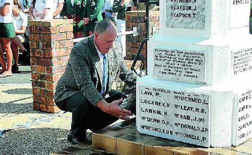 Jim Watts, representing the RAN, lays a wreath at Yamba.