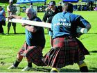 Simon Allard (left) competes in the log wrestle event at the 107th Maclean Highland Gathering Games at Maclean Showground on Saturday.