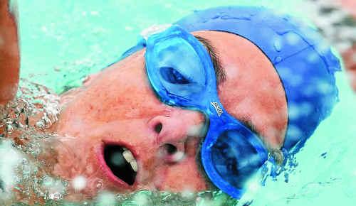 Kim Ryan competes in the swim leg at the Yamba Community pool.