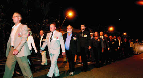 THE VETERANS: War veterans march along Gordon Street in the Mackay Anzac Day dawn parade. About 100 veterans marched in the parade.Photos: LEE CONSTABLE
