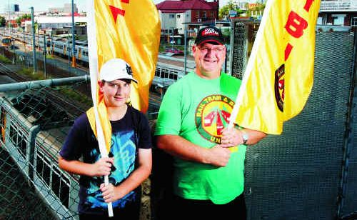 Rail, Tram and Bus Union Queensland branch organiser Ross Schimke, with his son Quinn, will lead Ipswich's Labour Day march.