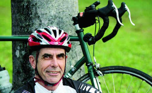 Peter McCallum rides Mackay's streets in preparation for a 1200km ride through France.
