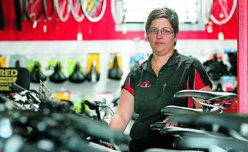 City Centre Cycles owner Roseleigh Cowie in her store that was broken into twice at the Easter weekend.