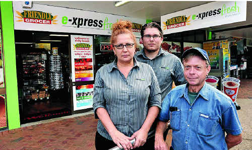 Owners of Express Fresh at Dicky Beach Theona Abram and Cody Barton, with landlord Gary Ratcliffe (right). The store was the target of an arson attack.