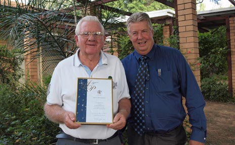 TERRENCE (TERRY) O'SULLIVAN is presented with an award by the Member for Lockyer, Ian Rickuss,for 50 years of service as a Justice of the Peace.