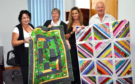 MARGARET AND DARRELL Wise from Bruny Island, Tasmania visited Queensland to hand over intricate quilts to the Lockyer Valley Regional Council, accepted by Cr Janice Holstein and Cr Tanya Milligan.
