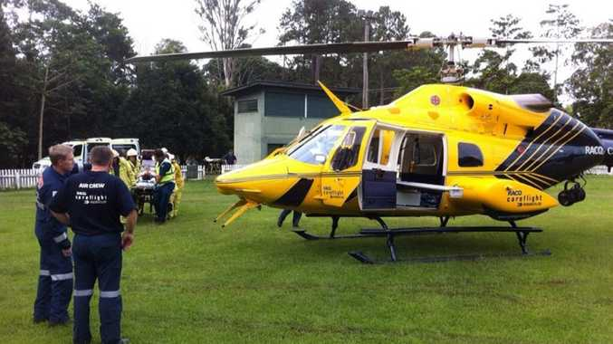 A man is prepared for an emergency flight after two vehicles collided with a truck at Landsborough.