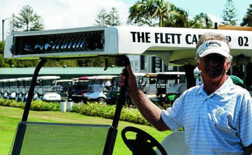 Yamba golfer Geoff Flett stands proudly with his new golfing invention which he has patented, the Flett Cart.