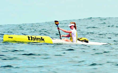 Maroochydore's Alyce Burnett heads for victory in the King Of The Coast paddle race from Moffat Beach to Mooloolaba last October.