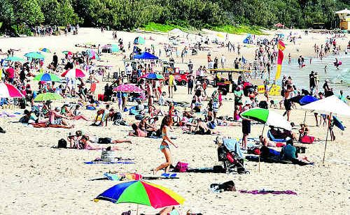 Easter crowds flocked to Main Beach in Noosa to enjoy the sunshine.